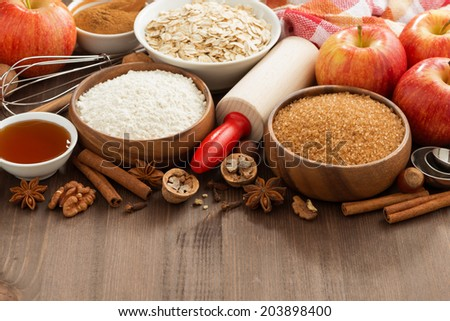 ingredients for baking cake on a wooden background, horizontal, close-up - stock photo