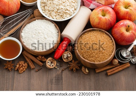 ingredients for baking cake on a wooden background, top view, close-up - stock photo