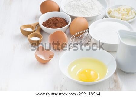 ingredients for baking on a white table, horizontal - stock photo