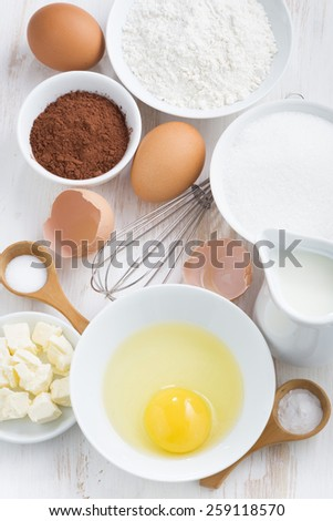 ingredients for baking on a white table, top view, vertical - stock photo