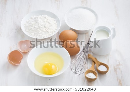 ingredients for baking on a white wooden table, horizontal, top view, close-up