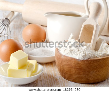 ingredients for baking on a wooden table . Selective focus