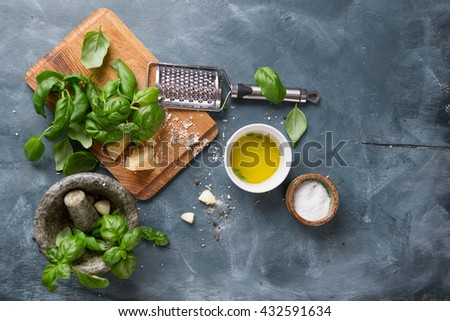 Ingredients for basil pesto  - parmesan cheese, basil, pine nuts, olive oil, garlic, salt and mortar, selective focus - stock photo