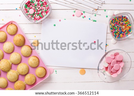 Ingredients for cake pops and empty tag  on white wooden background. Selective focus.Place for text. - stock photo