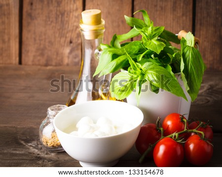 Ingredients for caprese salad over wooden wall, italian food - stock photo