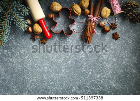 Ingredients for Christmas baking on dark background for copy space
