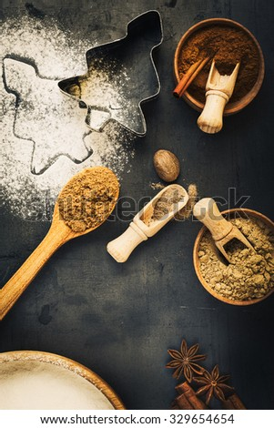 Ingredients for Christmas baking with copy space, flour, cinnamon, star anise, ginger, nutmeg, brown sugar, top view - stock photo