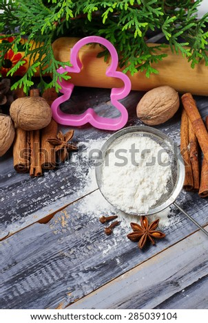 Ingredients for Christmas cookies - flour, anise, cinnamon. Selective focus, toned photo - stock photo
