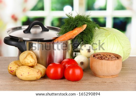 Ingredients for cooking borsch on table in kitchen