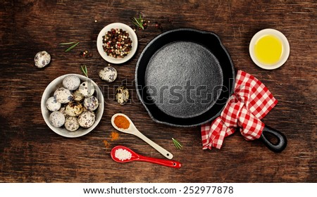Ingredients for cooking eggs and empty iron skillet - stock photo