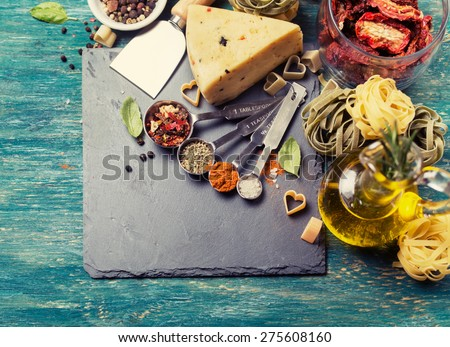 Ingredients for cooking Italian pasta, spices, cheese, olive oil. Top view - stock photo