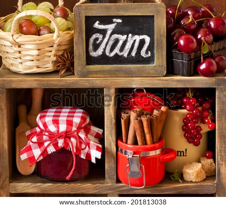 Ingredients for cooking jam. Fresh berries, spices and brown sugar on an old rustic shelves. Vintage style. - stock photo