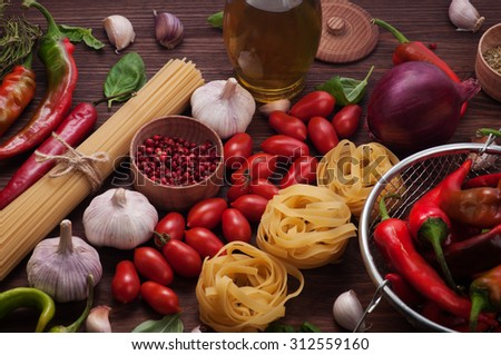 Ingredients for cooking pasta; Fresh juicy vegetables; Vegetarian concept; recipes; Cover for a cookbook; tomatoes; pepper; olive oil; bow; garlic; cherry;