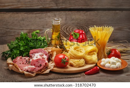 Ingredients for cooking pasta, Italian food, meat and spices, tomato, bell pepper, 
