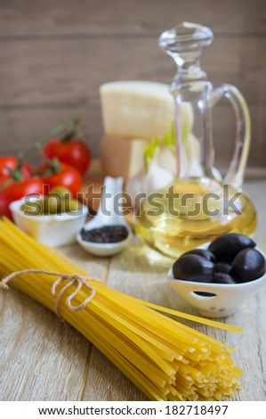 ingredients for cooking spaghetti with tomato sauce