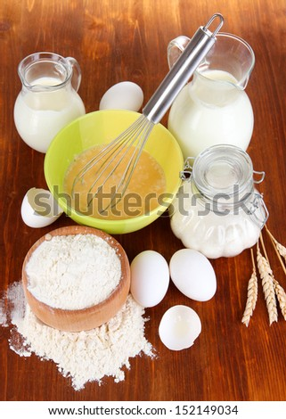 Ingredients for dough on wooden table close-up