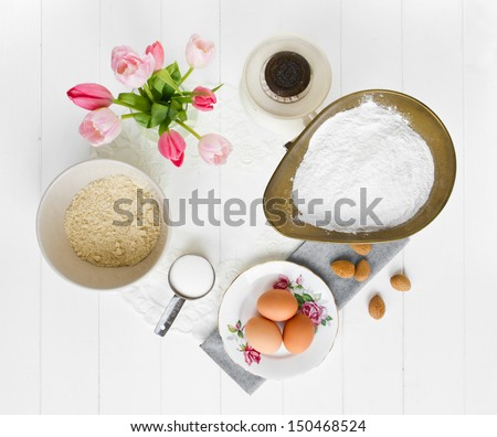 Ingredients for French macarons laid out. Ingredients include ground almonds (or almond flour), icing sugar (powdered or confectioners sugar), caster sugar and egg whites.