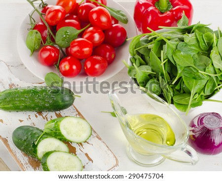 Ingredients for Fresh vegetable salad on white table - stock photo