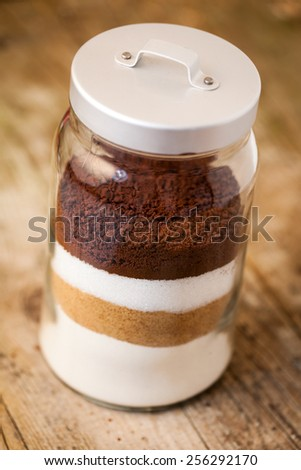 ingredients for home made cookies in a jar - stock photo