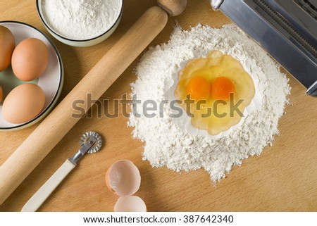 Ingredients for italian home made pasta; eggs and 