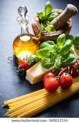 Ingredients for italian spaghetti on slate background - stock photo