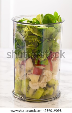 Ingredients for kiwi-smoothie, kiwi, banana, apple and lamb's lettuce, shaker - stock photo