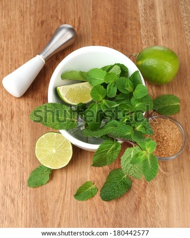 Ingredients for lemonade on wooden table