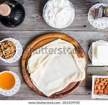 Ingredients for making homemade baklava,phyllo dough, nuts, honey, butter, top view, traditional Turkish dessert