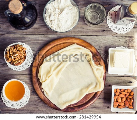 Ingredients for making homemade baklava,phyllo dough, nuts, honey, butter, top view, traditional Turkish dessert, tinted - stock photo