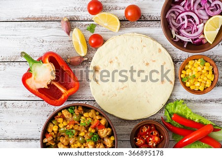Ingredients for Mexican tacos with meat, corn and olives on wooden background. Top view - stock photo