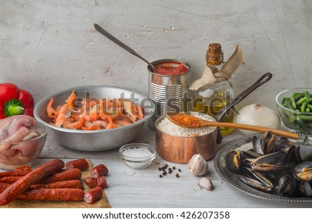 Ingredients for paella on the white scratched table horizontal - stock photo