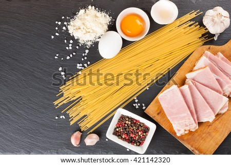 Ingredients for Pasta Carbonara on dark slate background. Top view. - stock photo