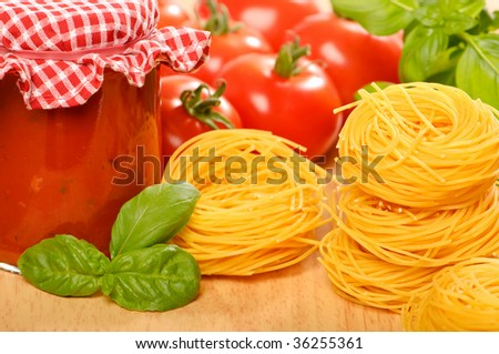 Ingredients for pasta in bolognaise sauce with basil - stock photo