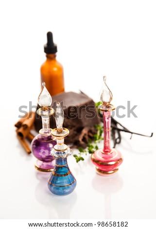 Ingredients for Perfume Making Cinnamon, Vanilla Beans, and Dark Chocolate with Few Storage  Bottles - stock photo