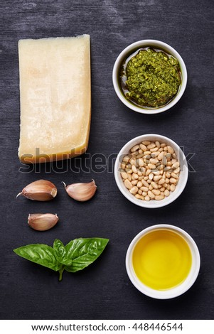 ingredients for pesto over dark background. top view