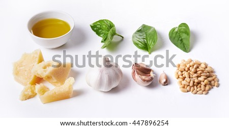 ingredients for pesto over white background