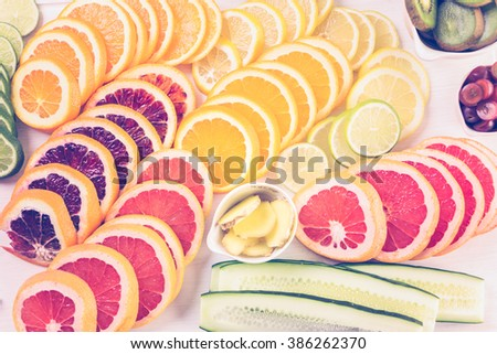 Ingredients for preparing detox citrus infused water as a refreshing summer drink. - stock photo