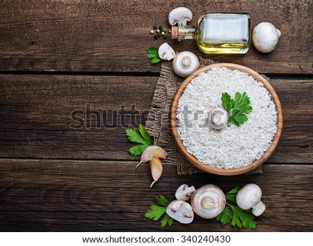 Ingredients for risotto: rice, mushroom, garlic, oil. Selective focus, space for text - stock photo