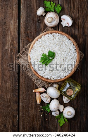 Ingredients for risotto: rice, mushroom, garlic, oil. Selective focus, top view - stock photo