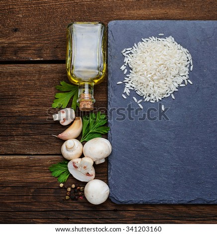 Ingredients for risotto: rice, mushroom, oil. Selective focus - stock photo