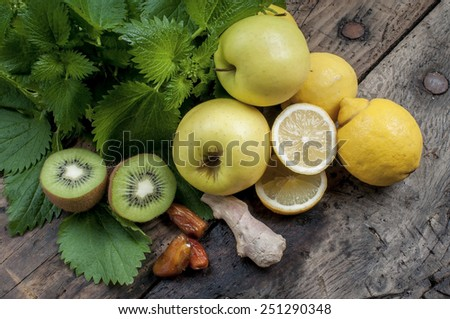 ingredients for shake nettles with kiwi apples and ginger detox drink for a vegetarian diet - stock photo
