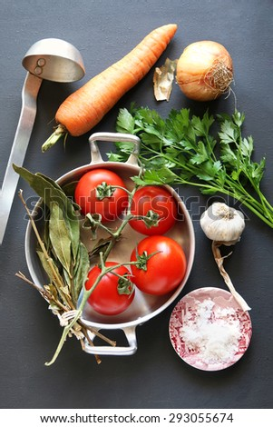 Ingredients for soup over dark background.Top view. - stock photo