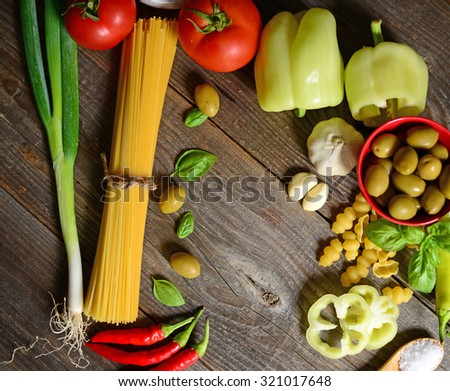 Ingredients for spaghetti bolognese on wooden background