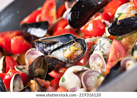 Ingredients for spaghetti with seafood. - stock photo
