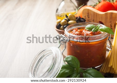 Ingredients for spaghetti with tomato sauce on wooden background. Italian healthy food background with copy space for text. - stock photo