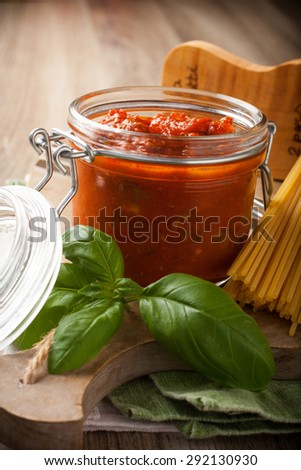 Ingredients for spaghetti with tomato sauce on wooden background. Italian healthy food background. - stock photo