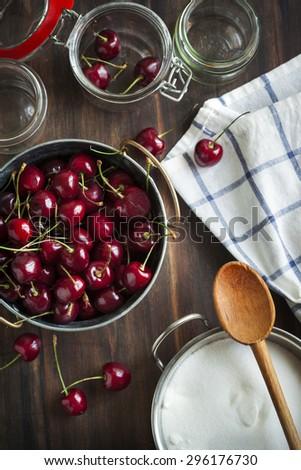 Ingredients for sweet cherry jam - stock photo