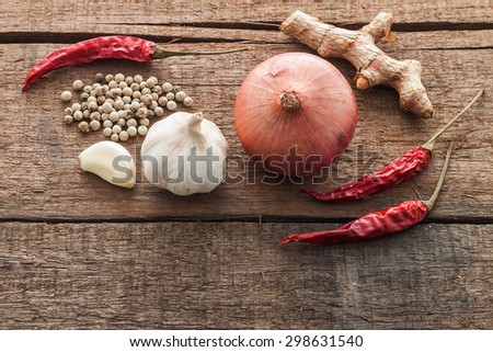 Ingredients for Thai's cuisine on wooden background(chili,shallot,ginger and pepper) - stock photo