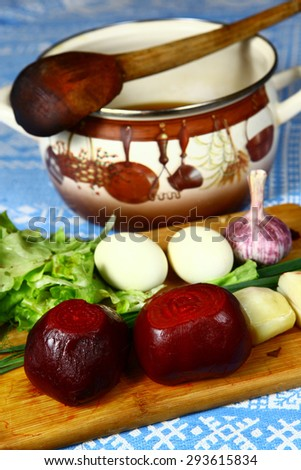 ingredients for the summer cold beet root soup and wooden country ladle - stock photo