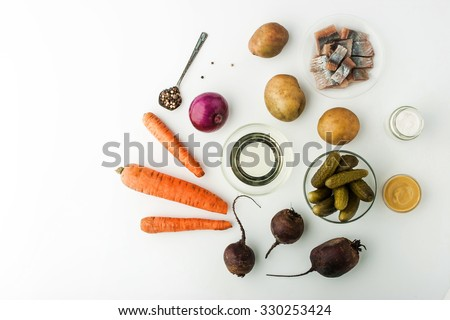 Ingredients for vegetable salad with beet and herring top view - stock photo